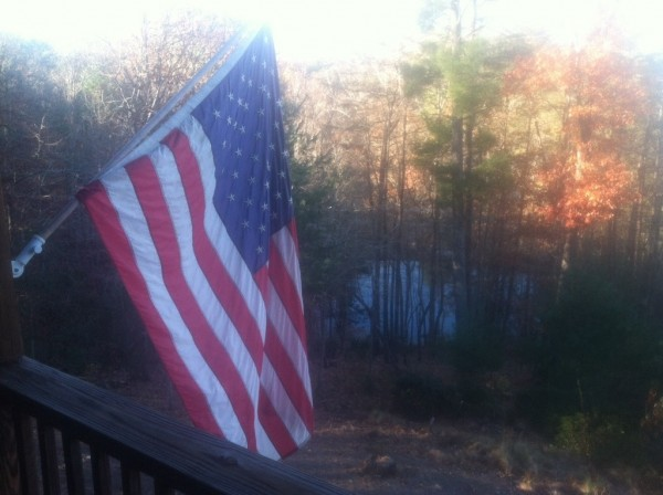 overlooking the lake from the deck with the American flag