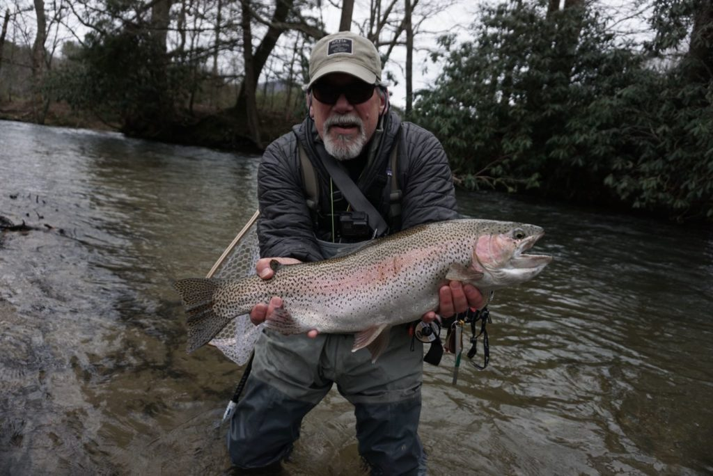 man with giant trout