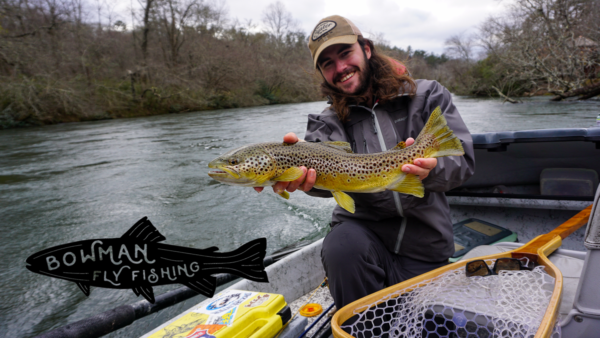 Daniel with catch and Bowman Fly Fishing Logo